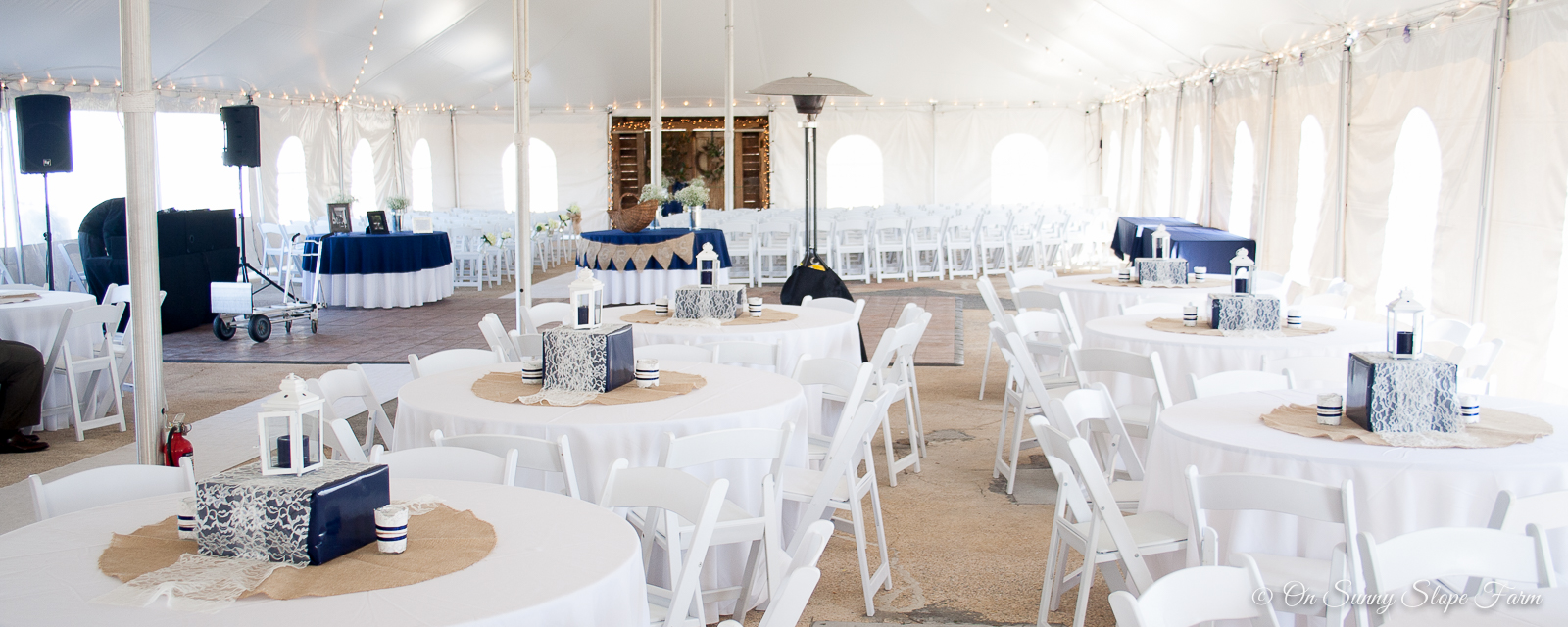 indoor-ceremony-setup-under-tent-on-sunny-slope-farm-1